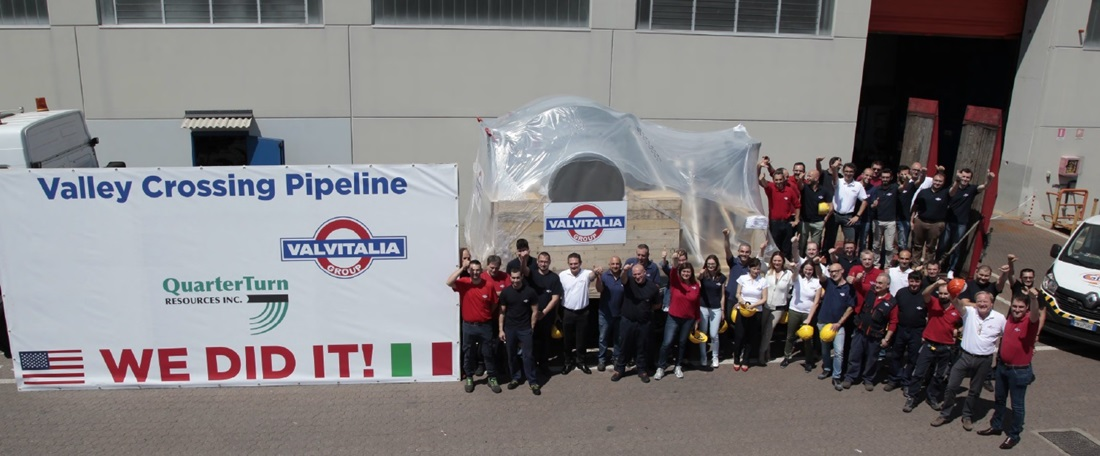 workers celebrating completion of giant valve